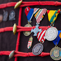 Medals are seen on the uniform of a soldier in period dress who attends the re-enactment of the historic battle against Austrian soldiers of the Habsburg dynasty in Tapiobicske, 80 km (50 miles) southeast of Budapest, Hungary on April 04, 2013. ATTILA VOLGYI