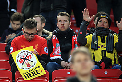 Fans in the stands hold up banners about the Sun Newspaper during the Premier League match at Anfield, Liverpool.
