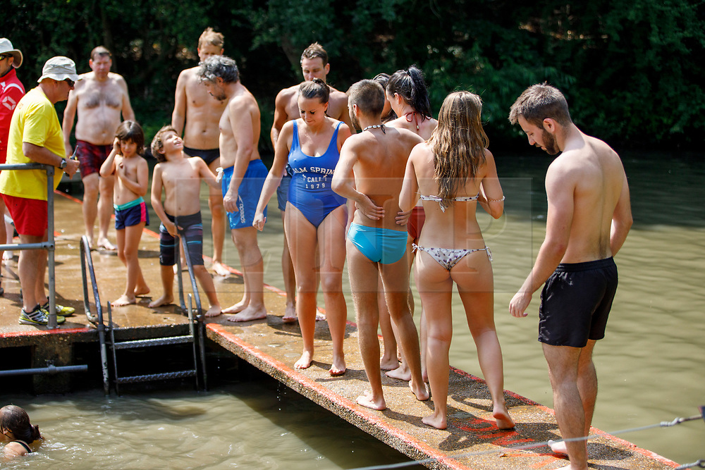 © Licensed to London News Pictures. 01/07/2018. London, UK. People swim in Hampstead Heath Mixed Bathing Pond in north London on Sunday, July 1, 2018 as heatwave has reached 31C and is set to continue into the next week and the unusually high temperatures look set to remain until the week after next. Photo credit: Tolga Akmen/LNP