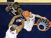 CHARLOTTESVILLE, VA- DECEMBER 6: Sammy Zeglinski #13 of the Virginia Cavaliers reaches for the rebound in front of Vertrail Vaughns #11 of the George Mason Patriots and Mike Scott #23 of the Virginia Cavaliers during the game on December 6, 2011 at the John Paul Jones Arena in Charlottesville, Virginia. Virginia defeated George Mason 68-48. (Photo by Andrew Shurtleff/Getty Images) *** Local Caption *** Sammy Zeglinski;Mike Scott;Vertrail Vaughns