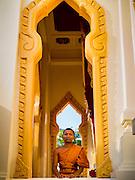 19 FEBRUARY 2015 - BANGKOK, THAILAND: A Buddhist monk at Wat Traimit in the Chinatown section of Bangkok.     PHOTO BY JACK KURTZ