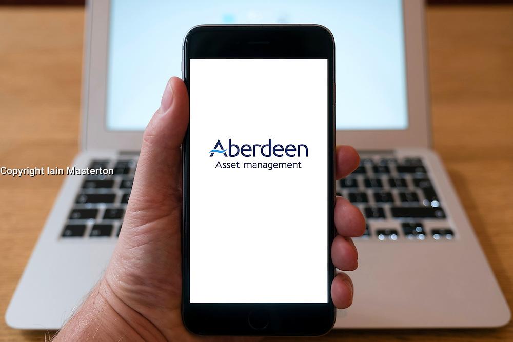Aberdeen Asset Management fund management company logo on smart phone screen.
