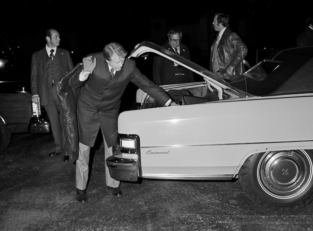 """Georgia Governor and 1976 Democratic presidential candidate Jimmy Carter arrives at an airstrip  in rural Illinois. Carter always insisted in carrying his own bags - forgoing the help of assistants or """"body men"""". - To license this image, click on the shopping cart below -"""