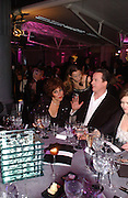 Ruby Wax and David Cameron. The Black and White Winter Ball. Old Billingsgate. London. 8 February 2006. -DO NOT ARCHIVE-© Copyright Photograph by Dafydd Jones 66 Stockwell Park Rd. London SW9 0DA Tel 020 7733 0108 www.dafjones.com