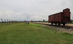A Deutsche Reichsbahn 'Gueterwagen' (goods wagon), one type of rail car used for deportations at the Auschwitz-Birkenau Nazi concentration camps in Auschwitz, Poland on September 3, 2017. Auschwitz concentration camp was a network of German Nazi concentration camps and extermination camps built and operated by the Third Reich in Polish areas annexed by Nazi Germany during WWII. It consisted of Auschwitz I (the original camp), Auschwitz II–Birkenau (a combination concentration/extermination camp), Auschwitz II–Monowitz (a labor camp to staff an IG Farben factory), and 45 satellite camps. In September 1941, Auschwitz II–Birkenau went on to become a major site of the Nazi Final Solution to the Jewish Question. From early 1942 until late 1944, transport trains delivered Jews to the camp's gas chambers from all over German-occupied Europe, where they were killed en masse with the pesticide Zyklon B. An estimated 1.3 million people were sent to the camp, of whom at least 1.1million died. Around 90 percent of those killed were Jewish; approximately 1 in 6 Jews killed in the Holocaust died at the camp. Others deported to Auschwitz included 150,000 Poles, 23,000 Romani and Sinti, 15,000 Soviet prisoners of war, 400 Jehovah's Witnesses, and tens of thousands of others of diverse nationalities, including an unknown number of homosexuals. Many of those not killed in the gas chambers died of starvation, forced labor, infectious diseases, individual executions, and medical experiments. In 1947, Poland founded a museum on the site of Auschwitz I and II, and in 1979, it was named a UNESCO World Heritage Site. Photo by Somer/ABACAPRESS.COM