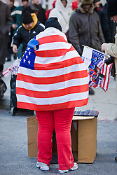 Lady wrapped in flag at Presidential Inauguration of Barack Obama, Washington D.C., USA.