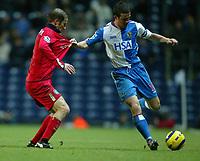 Fotball<br /> Premier League England 2004/2005<br /> 21.11.2004<br /> Foto: SBI/Digitalsport<br /> NORWAY ONLY<br /> <br /> Blackburn v Birmingham<br /> Barclays Premiership. 21/11/2004. <br /> <br /> Barry Ferguson of Blackburn Rovers holds off Kenny Cunningham of Birmingham City.