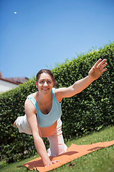 Pregnant woman fitness garden stretching
