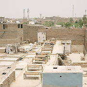 Beds are lined up for sleeping on the roof. Because of the extreme heat and lack of electricity, people sleep outside.