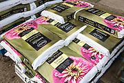 Bags of multi-purpose peat based compost on sale Ladybird Nurseries garden centre, Gromford, Suffolk, England, UK