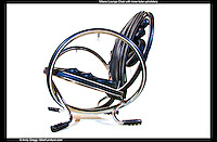 Milano Lounge Chair - Handcrafted from bicycle rims, tires,  and handlebars..This version is upholstered with bicycle inner-tubes. Cushioning is provided by adding air to designated tubes.