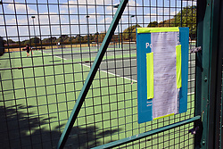 As the Coronavirus lockdown eases, tennis courts reopen but with strict social distancing rules, Eaton Park, Norwich UK May 2020