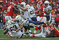 KANSAS CITY, MO - NOVEMBER 24:  Running back Danny Woodhead #39 of the San Diego Chargers dives over the goal line for a touchdown against the Kansas City Chiefs during the second half on November 24, 2013 at Arrowhead Stadium in Kansas City, Missouri.  San Diego won 41-38. (Photo by Peter Aiken/Getty Images) *** Local Caption *** Danny Woodhead