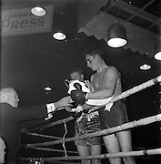 26/01/1962<br /> 01/26/1962<br /> 26 January 1962<br /> Irish Amateur National Junior Boxing Championships at the National Stadium, Dublin. Presentation of Middleweight Junior Cup to J. Fairbrother (St. Francis, Limerick)Just behind is his opponent, D. Murray (Matt Talbot).