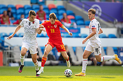 CARDIFF, WALES - Saturday, June 5, 2021: Wales' David Brooks (R) and Albania's Berat Djimsiti during an International Friendly between Wales and Albania at the Cardiff City Stadium in their game before the UEFA Euro 2020 tournament. (Pic by David Rawcliffe/Propaganda)