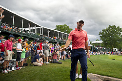 May 5, 2019 - Charlotte, North Carolina, United States of America - Rory McIlroy waves to young fans while exiting the eighteenth green after finishing his round during the final round of the 2019 Wells Fargo Championship at Quail Hollow Club on May 05, 2019 in Charlotte, North Carolina. (Credit Image: © Spencer Lee/ZUMA Wire)