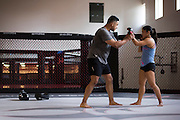 Coach Joey Villasenor works with Bi Nguyen of Vietnam during a private lesson at Jackson Wink MMA in Albuquerque, New Mexico on June 9, 2016.