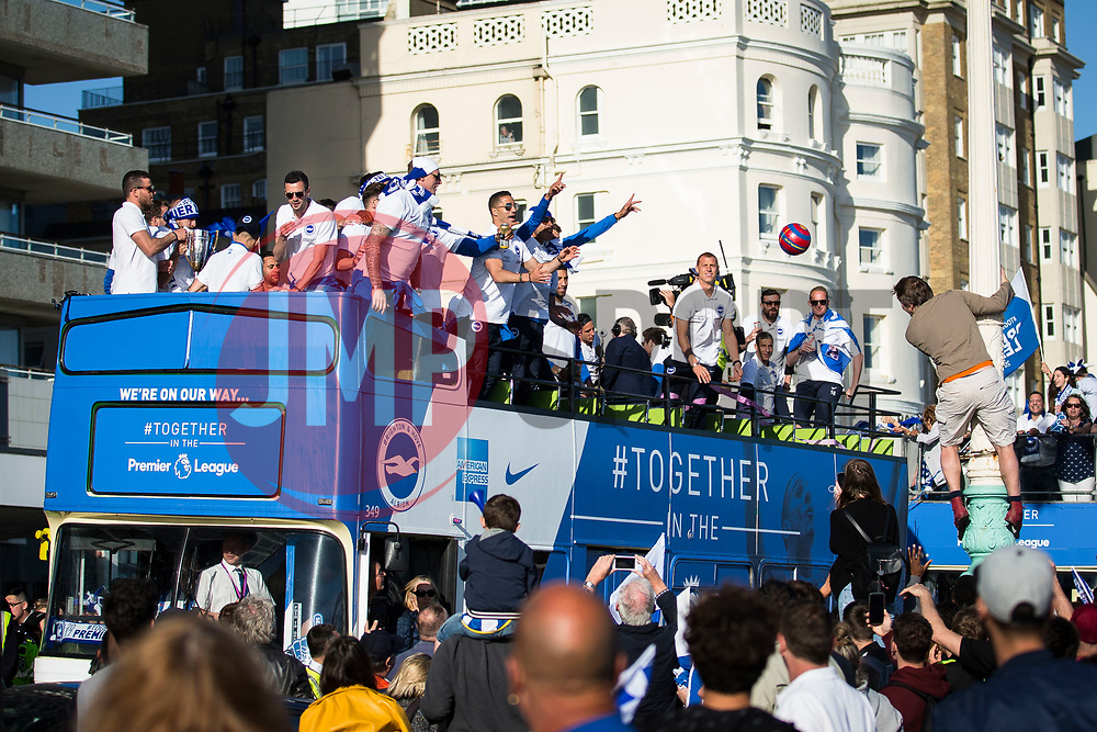 Brighton & Hove Albion players throw a ball out to a fan on a nearby lamp post - Mandatory by-line: Jason Brown/JMP - 14/05/17 - FOOTBALL - Brighton and Hove Albion, Sky Bet Championship 2017 - Brighton and Hove Albion Promotion Parade
