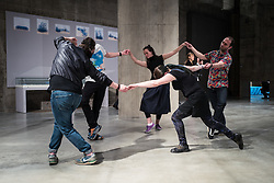 © Licensed to London News Pictures. 14/06/2016. London, UK. Performance artists perform in one of the 'Tanks' at the Switch House, the new Tate Modern building which opens to the public on Friday 17 June 2016. The ten-storey extension was designed by architects Herzog & de Meuron and includes the world's first gallery space dedicated exclusively to live art, film and installations. Photo credit: Rob Pinney/LNP