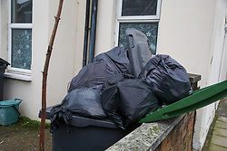 © Licensed to London News Pictures. 28/12/2020. London, UK. Bags of rubbish are gathered in bins in a front garden in London after the festive period. Photo credit: Dinendra Haria/LNP
