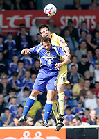 Photo: Mike Greenslade..Cardiff City v Sheffield Wednesday..Coca Cola Championship League..07.04.07..Ninian Park..KO 3pm...Owls defender Richard Wood beats Cardiff's Michael Chopra in the AIR