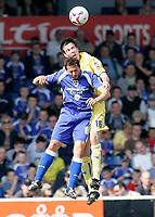 Photo: Mike Greenslade..Cardiff City v Sheffield Wednesday..Coca Cola Championship League..07.04.07..Ninian Park..KO 3pm...Owls defender Richard Wood beats Cardiff's Michael Chopra in the AIR