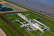 Nederland, Groningen, Gemeente Eemsmond, 01-05-2013; Waddenkust ten noorden van Uithuizen. Landaanwinning en zicht op aanlandingspunt van ondergrondse transportleiding voor gas.  Behandelingsstation en gascompressorstation voor aardgas van Gasunie-transportservices.<br /> Coast of the Waddensea (North Netherands) Land reclamation and view on landing point  underground gas transport line. Treatment and gas compressor station for Gasunie gas transport services.<br /> luchtfoto (toeslag op standard tarieven)<br /> aerial photo (additional fee required)<br /> copyright foto/photo Siebe Swart