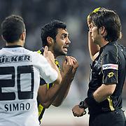 Referee's Firat AYDINUS show the yellow card to Fenerbahce's Bekir IRTEGUN (C) during their Turkish Superleague Derby match Besiktas between Fenerbahce at the Inonu Stadium at Dolmabahce in Istanbul Turkey on Thursday, 207 October 2011. Photo by TURKPIX