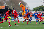 Accrington Stanley goalkeeper Dimitar Evtimov (30) dropping a  cross during the EFL Sky Bet League 1 match between AFC Wimbledon and Accrington Stanley at the Cherry Red Records Stadium, Kingston, England on 6 April 2019.