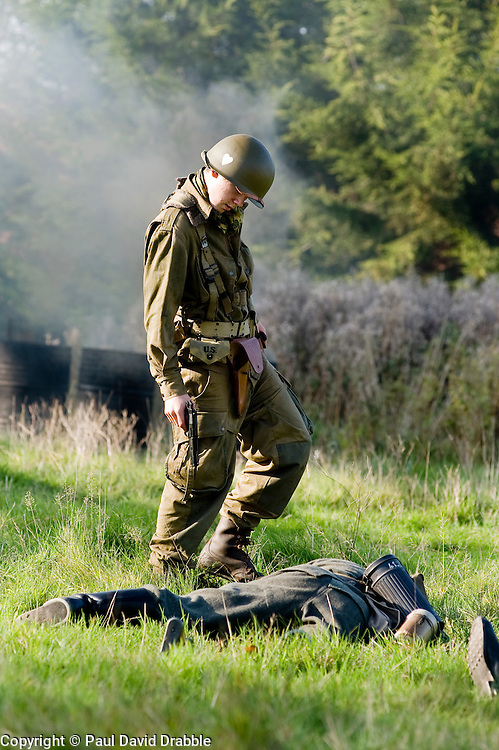 Reenactors portraying US Airborne troops check that German troops are dead during a small scale Skirmish at the Northallerton Wartime weekend charity fundraiser for Help for Heros and Ben Hyde Memorial Trust 9th &10th Ocober 2010 .Images<br /> © Paul David Drabble