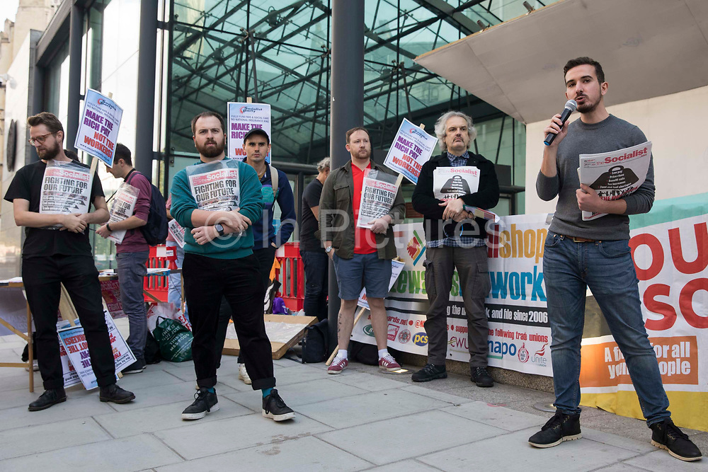 Berkay Kartav r, Youth Fight for Jobs organiser, addresses activists outside the Department for Business, Energy and Industrial Strategy BEIS before a London March for Jobs on 9th October 2021 in London, United Kingdom. The march was organised by London Young Socialists and Youth Fight for Jobs, a youth organisation formed in 2009 in response to a rise in youth employment following the 2007-2008 financial crash, to call for decent jobs for young people, a £15ph minimum wage and an end to zero-hour contracts. .