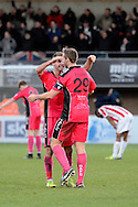 Match winner Connor Essam celebrates victory during the The FA Cup match between Cheltenham Town and Dover Athletic at Whaddon Road, Cheltenham, England on 7 December 2014.