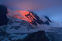 Dawn at Grosglockner Mountain, the highest peak of Austria at cloudy and rainy morning. Hohe Tauern National Park, Carinthia, Austria