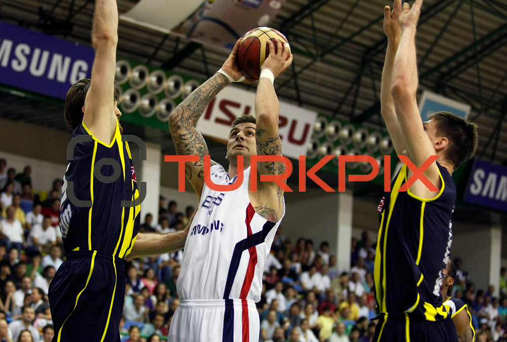 Efes Pilsen's Mario KASUN (C) during their Turkish Basketball league Play Off Final fifth leg match Efes Pilsen between Fenerbahce Ulker at the Ayhan Sahenk Arena in Istanbul Turkey on Sunday 30 May 2010. Photo by Aykut AKICI/TURKPIX