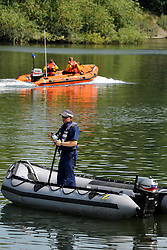 © licensed to London News Pictures. RICHMOND, UK.  01/08/11. The RNLI were called in to help in the search. The Metropolitan police search the River Thames near Richmond, London, today (1 Aug 2011) after a 17 year boy went missing after taking part in a kayak competition.  Mandatory Credit Stephen Simpson/LNP