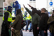 Facist demonstrators show the nazi salute as the clash with Anti Facist demonstrators marching through Dover at a counter demonstration also taking place in the port town. 30th January 2016