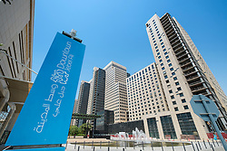 View of modern office buildings under construction at Jebel Ali Downtown commercial property development in Dubai United Arab Emirates