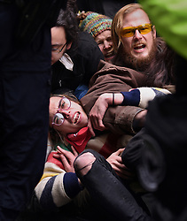 January 20, 2017 - Washington, DC, U.S - Anti-Trump protesters form a blockade at security checkpoints during President Donald Trump's inauguration in Washington, D.C., on Jan. 20, 2017. (Credit Image: © Carol Guzy via ZUMA Wire)