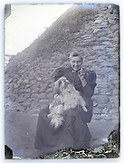 casual portrait of adult woman with pet dog Paris 1900s