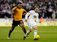 Photo: Leigh Quinnell.<br /> Wolverhampton Wanderers v Leeds United. Coca Cola Championship. 17/12/2005. Leeds' Eddie Lewis comes under attack from Wolves' Tom Huddlestone.