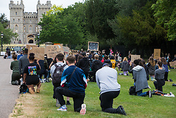 Hundreds of young people take a knee in front of Windsor Castle in memory of George Floyd before a peaceful protest march in solidarity with the Black Lives Matter movement on 4th June 2020 in Windsor, United Kingdom. The march, along the Long Walk in front of Windsor Castle, was organised at short notice by Jessica Christie at the request of her daughter Yani, aged 12, following the death of George Floyd while in the custody of police officers in Minneapolis in the United States.
