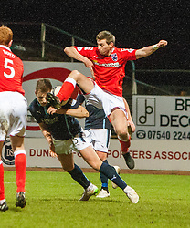 Dundee's Greg Stewart and Ross County's Steven Saunders. <br /> Dundee 1 v 1 Ross County, SPFL Premiership game player 4/1/2015 at Dundee's home ground Dens Park.