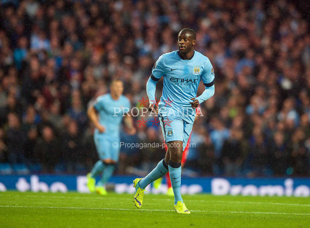 MANCHESTER, ENGLAND - Monday, August 25, 2014: Manchester City's Yaya Toure in action against Liverpool during the Premier League match at the City of Manchester Stadium. (Pic by Chris Brunskill/Propaganda)