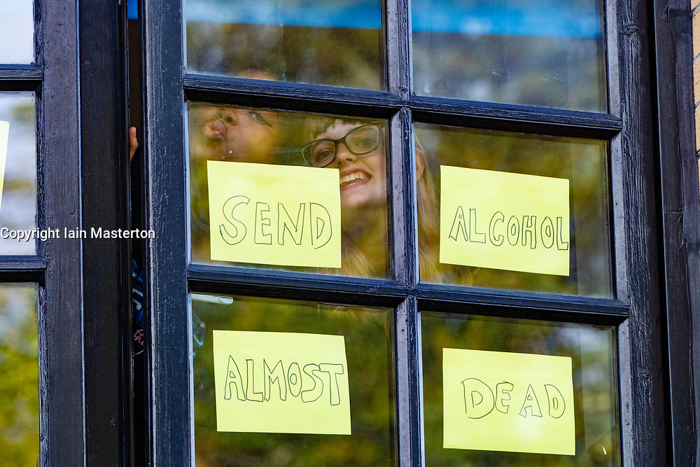 Glasgow, Scotland, UK. 27 September, 2020. Students self-isolating inside their halls of residence at Murano Street in Glasgow have put messages in their windows. Most in the accommodation blocks have been trapped inside for 5 days.  Iain Masterton/Alamy Live News