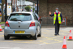 © Licensed to London News Pictures. 04/06/2020. London, UK. A staff member manages the traffic at McDonald's Drive Thru in north London. McDonald's Drive Thru opens in Haringey, after lockdown restrictions are relaxed. <br /> <br /> ***Permission Granted***<br /> <br /> Photo credit: Dinendra Haria/LNP