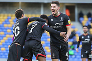 Lincoln City players celebrate the opening goal 1-0 during the EFL Sky Bet League 1 match between AFC Wimbledon and Lincoln City at Plough Lane, London, United Kingdom on 2 January 2021.