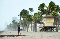 A man takes a souvenir photo along the beach in heavy winds in anticipation for Hurricane Irma Saturday, September 9, 2017 in Hollywood, FL, USA. Photo by Paul Chiasson/CP/ABACAPRESS.COM