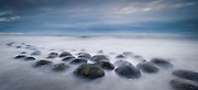 """Sandstone concretions at """"Bowling Ball Beach"""" on Northern California's  Mendocino County Coastline near Gualala. These unusual natural orbs can be up to one meter in diameter and are only found in New Zealand and on the Mendocino Coast."""