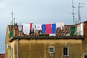 Clothes drying on rooftop landing, Makarska, Croatia
