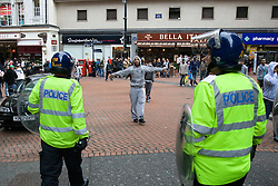© Licensed to London News Pictures. 29/10/2011. Birmingham, UK. FILE PICTURE DATED 05/09/2009. A young Asian man faces off against police during an English Defence League demonstration in September 2009. Photo credit : Joel Goodman/LNP